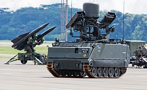 Republic of Singapore Air Force - Demonstration of a M-113A2 Ultra Mechanised Igla IFU on deployment, visible in the background is an I-HAWK SAM launcher.