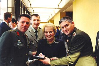 Madeleine Albright - With NATO officers during NATO Ceremony of Accession of New Members, 1999
