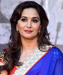 Madhuri Dixit is seen looking away from the camera.