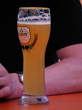 Beer head - A glass of beer with the head having receded, leaving behind noticeable lacing