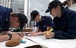 Making corrections to a nautical chart 110615-G-EM820-306.jpg
