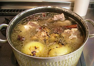 Stock (food) - Making stock in a pot on a stove top