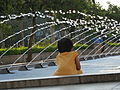 Malaysia - 044 - KL - girl more interested in teh fountain than the towers (3528767562).jpg