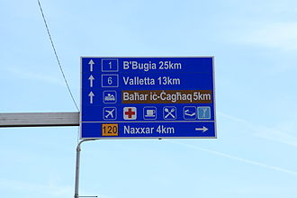 Comparison of traffic signs in English-speaking countries - Most road signs come in a different language rather than English. Example shows a road sign in Malta in Maltese language.