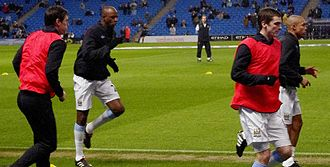 Gareth Barry - Barry, Patrick Vieira, Adam Johnson and Nigel de Jong warming up for Manchester City in February 2010
