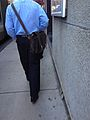 Man carrying brown satchel - IMG 6259.jpg