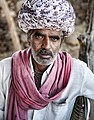 Man with a big turban and a read scarf, Rajasthan (6358509063).jpg