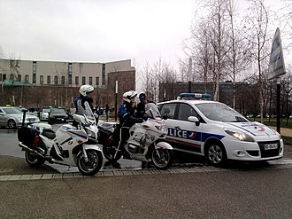 Law enforcement in France - Policemen with motorcycles and a car in Strasbourg.