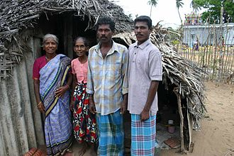 Vedda - Vedda villagers from Mankery in Batticaloa district wearing sarongs and other traditional attire.