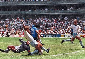 "Argentina v England (1986 FIFA World Cup) - Maradona scoring the ""Goal of the Century"" after dribbling past goalkeeper Peter Shilton. Butcher (6) fails to stop the shot."