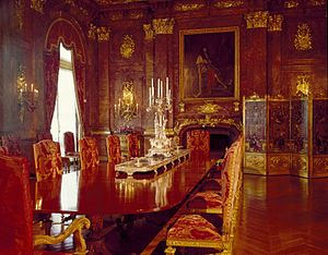 Marble House - The dining room, featuring pink Numidian marble and gilt bronze capitals and trophies.