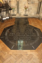 "Black marble memorial set into the floor that reads: ""In remembrance of all those who drowned when the motor vessel Marchioness was struck near Southwark Bridge on Sunday 20 August 1989. Many waters cannot quench love"""