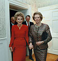 Margaret Thatcher Nancy Reagan with husbands behind.jpg