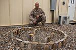 Marine leaves 'no rock unturned' creating deployment art 131124-M-ZB219-021.jpg