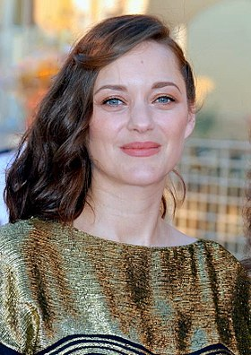 Marion Cotillard won for her portrayal of Edith Piaf in La Vie en Rose (2007), becoming the first person to win for a French-language film Marion Cotillard Cabourg 2017.jpg