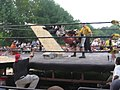 Masada body slamming Scotty Vortekz onto cinderblocks!.jpg
