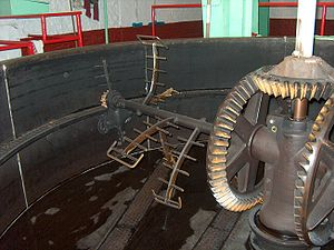 Mashing - An empty mash tun showing the integrated mash rake.