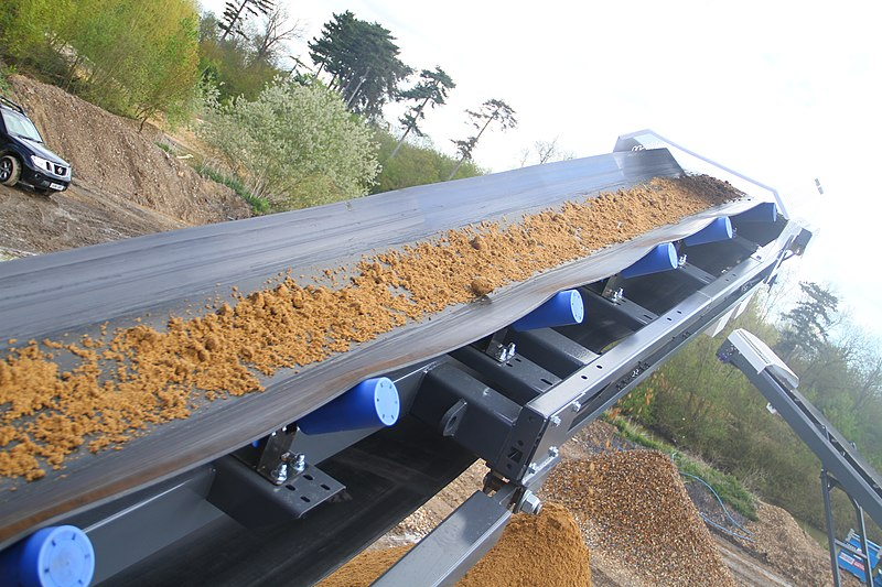 File:Material on conveyor during commissioning (7548464136).jpg
