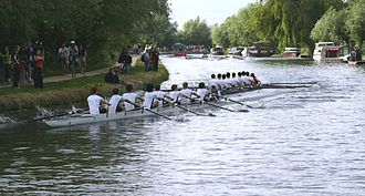 "River Cam - A Caius eight on the lower river about to be ""bumped"" by 1st & 3rd Trinity during the May Bumps rowing races 2005"