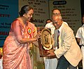 Meira Kumar presenting Vayoshrestha Samman-2006 under sports category to the 74 years old Shri Nikhil Kumar Nandy from Kolkata, as a part of International Day of Older persons, in New Delhi on October 17, 2006.jpg