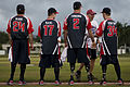 Members of the Wounded Warrior Amputee Softball Team (WWAST) greet members with the Hickam Force and Hickam Chiefs teams during player introductions 130108-F-ZB240-730.jpg