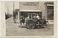 Men and children with automobile in front of Coryell Produce Co. (6973093066).jpg