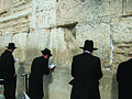 Men in black at the Western Wall.jpg
