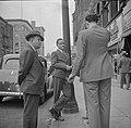 Men talk, street scene at (High Street,) Holyoke, Massachusetts (1941).jpg
