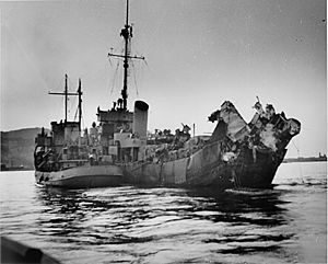 USS Menges (DE-320) - The severely damaged Menges under tow.