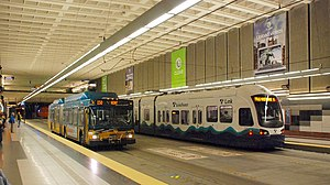 Downtown Seattle Transit Tunnel - Image: Metro bus and Link light rail passing at University Street Station (2010)