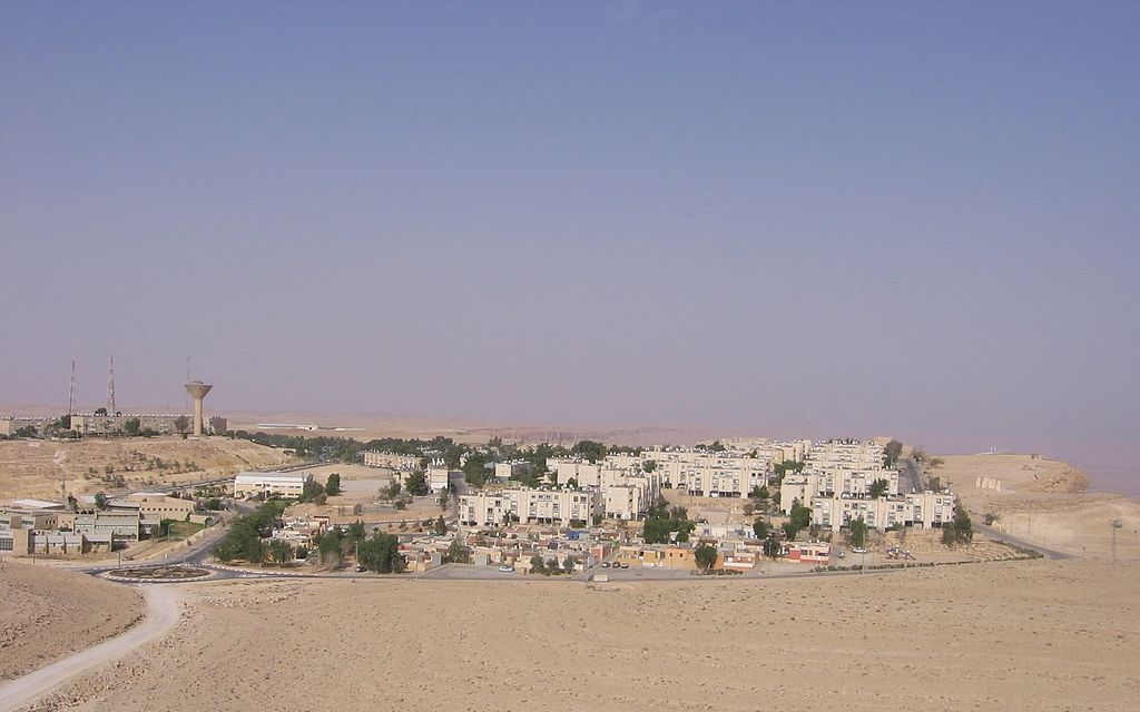 a small town surrounded by sand