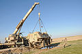 Mobile crane lifts a Fuchs tank.jpg