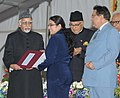"Mohd. Hamid Ansari presenting the award to a young scientist, at the valedictory function of the ""101st Session of Indian Science Congress"", at University of Jammu.jpg"
