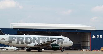 Cincinnati/Northern Kentucky International Airport - Frontier A320 taxiing from Concourse A in front of the Delta hangar