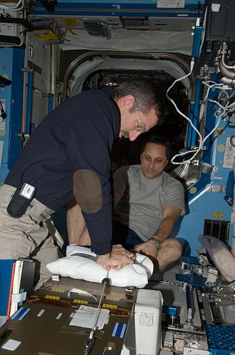Space medicine - Dan Burbank and Anton Shkaplerov participate in a medical contingency drill in the Destiny laboratory of the International Space Station. This drill gives crew members the opportunity to work as a team in resolving a simulated medical emergency on board the space station.