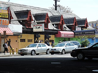 Hunts Point, Bronx - Looking east, zoomed, from under Bruckner Expressway at former Hunt's Point station now serving shops