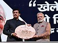 Narendra Modi and the Minister of State for Youth Affairs and Sports (IC) and Information & Broadcasting, Col. Rajyavardhan Singh Rathore, at the inauguration of the first edition of Khelo India School Games.jpg