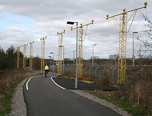 National Cycle Route 21 - NCR 21 passing the runway approach lights at Gatwick Airport