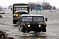 National Guard trucks ford flood in Minnesota.jpg