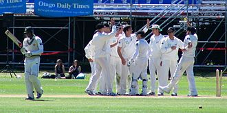 The New Zealand team celebrating a dismissal in 2009 New Zealand cricket team, Shoaib Malik, Dunedin, NZ, 2009.jpg