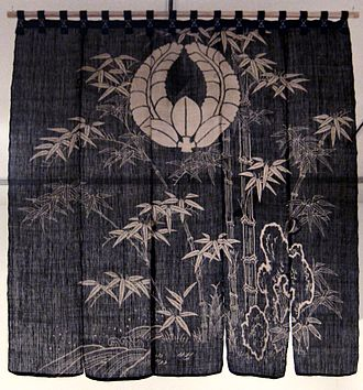 Tsutsugaki - Curtain (noren) in hemp and cotton with tsutsugaki dip-dyed in indigo and brushed sumi ink, from the Meiji period (Honolulu Museum of Art)
