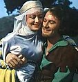 Olivia de Havilland and Errol Flynn in The Adventures of Robin Hood trailer (cropped).JPG