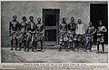 One man is sitting behind a locked door and others are lined Wellcome V0041210.jpg