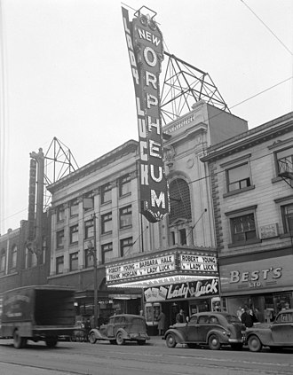 Granville Street - The Orpheum Theatre with advertising for the movie Lady Luck (dated about 1946); note the Commodore Ballroom on the left