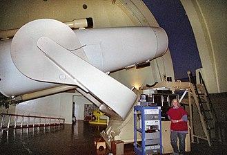 Palomar Observatory - Astronomer Jean Mueller posing with the Samuel Oschin Telescope (Schmidt Camera)