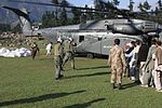 Pakistani flood victims board a U.S. Navy MH-53E Sea Dragon helicopter from Helicopter Mine Countermeasures Squadron (HM) 15, Detachment 2 during humanitarian relief efforts in Khyber-Pakhtunkhwa province 100821-M-ZG155-814.jpg
