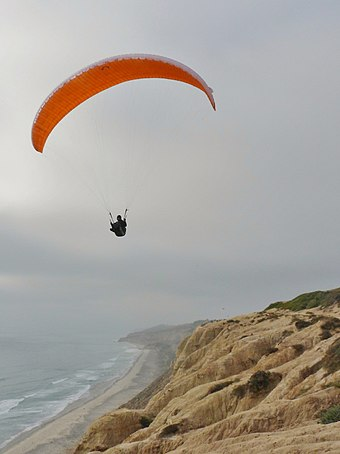 Ridge soaring along the California coast Paraglider ridge soaring at Torrey Pines.jpg