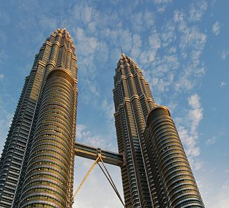 The Petronas Towers, the headquarters of the national oil company Petronas and are the tallest twin-towers in the world. Petronas Towers by Day-Edit(ws).jpg