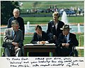 Photo of President George H. W. Bush signing the Americans with Disabilities Act inscribed to Justin Dart, Jr., 1990.jpg