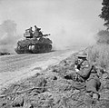 Pierre Lefevre, a Free French war correspondent, making a broadcast as a Sherman Firefly tank moves up to the battle area, Normandy, 5 August 1944. B8710.jpg